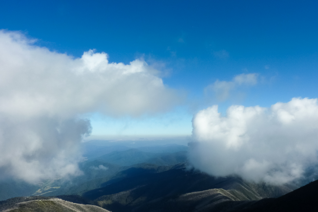 blue-sky-clouds-below-mt-feathertop