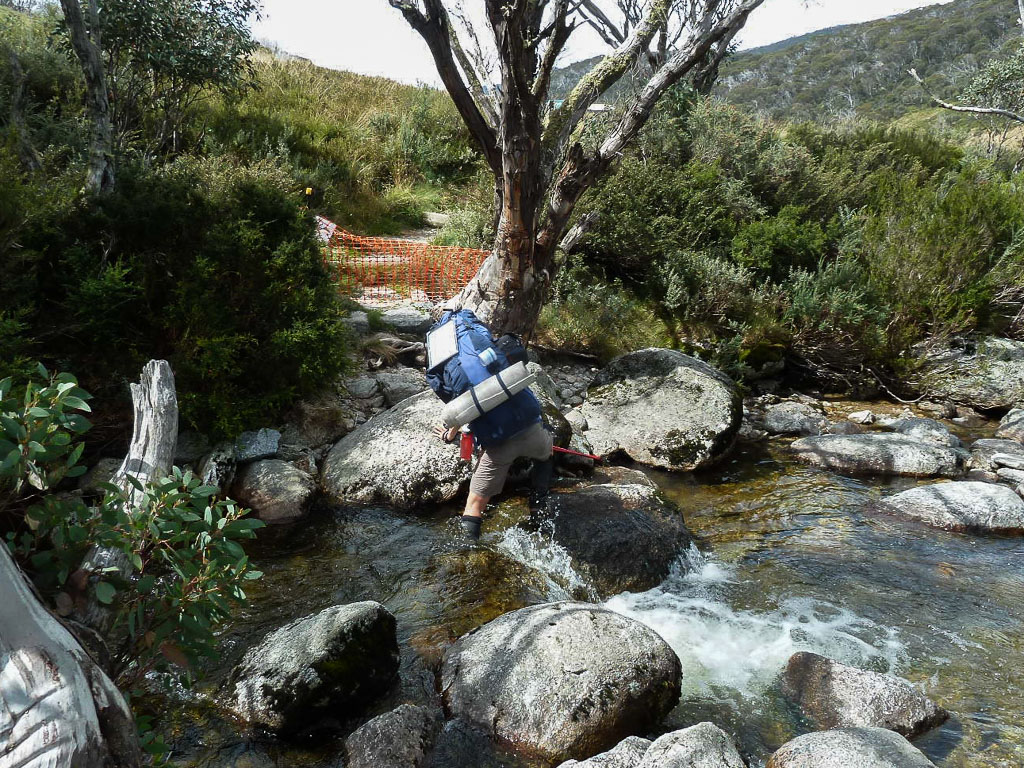 leg-in-water-crossing-thredbo-river-snowy-mountains