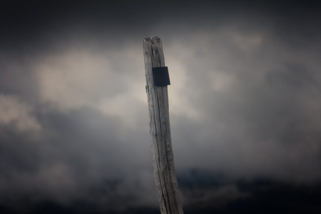 wooden-post-dark-clouds