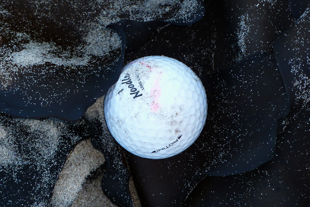 golf-ball-on-beach-seaweed