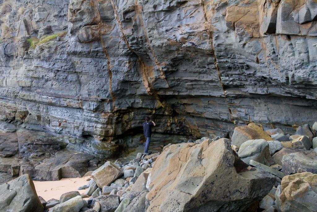 standing-under-cliffs-coast