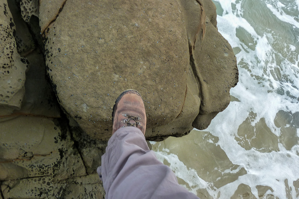 stepping-between-rocks-near-water