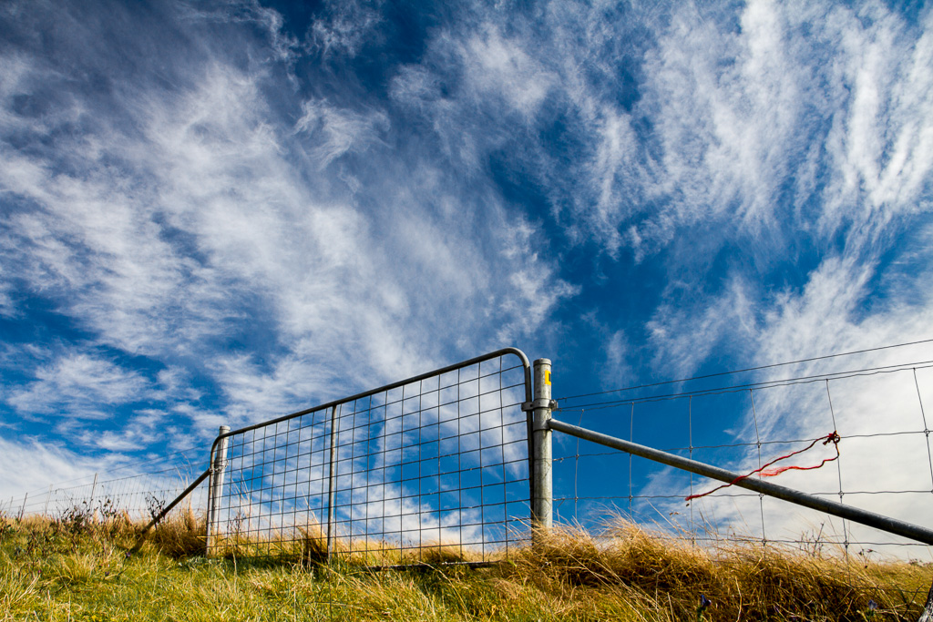 farm-gate-fence-polarised-sky
