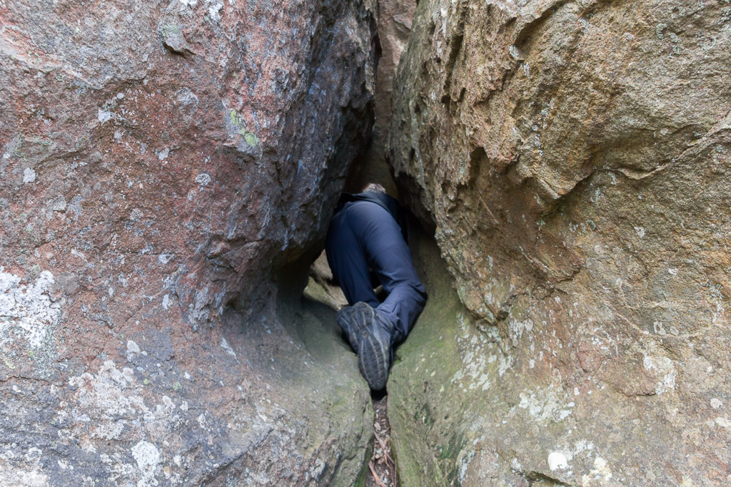 crawling-narrow-gap-between-boulder-hanging-rock
