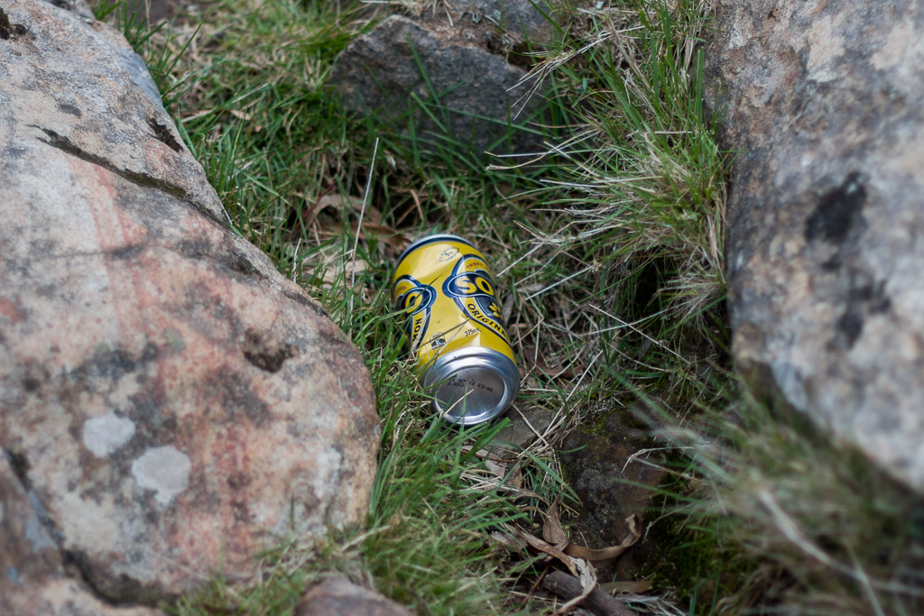 discarded-drink-can-hanging-rock