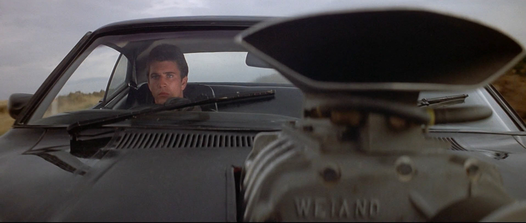 driving-black-interceptor-mad-max-1979