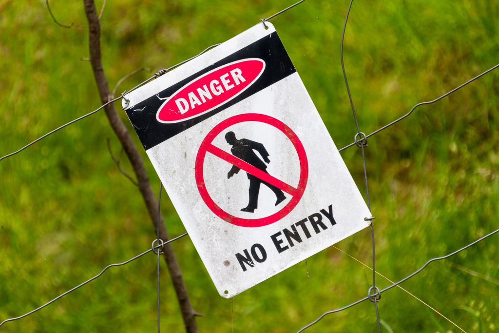 warning-sign-on-fence