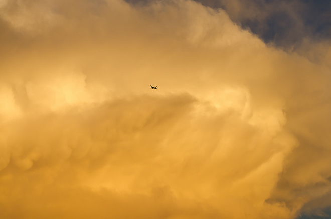 plane-sunset-cumulus-clouds