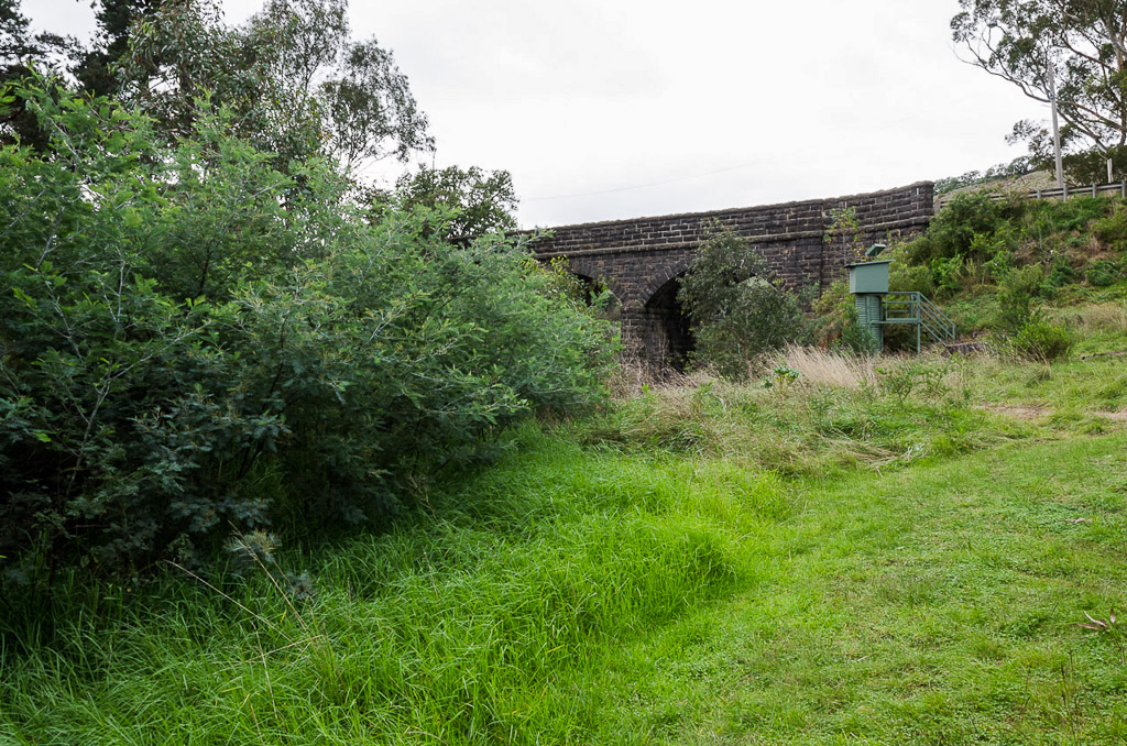 bulla-bridge-behind-trees
