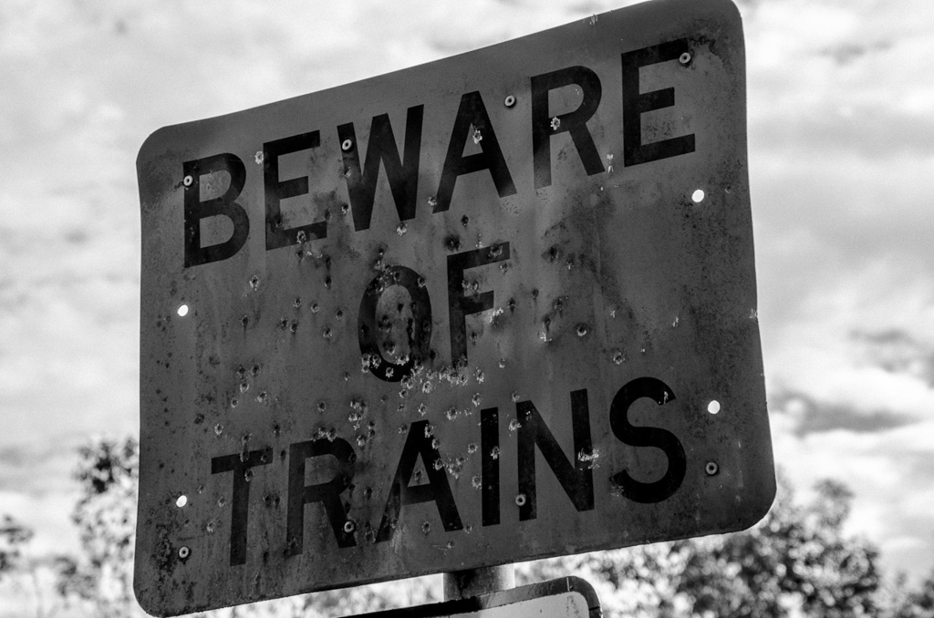 beware-of-trains-sign-bullet-holes