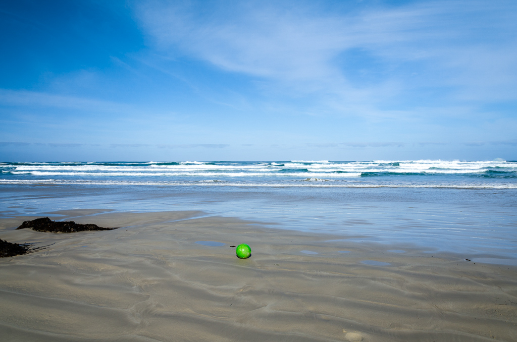 green-buoy-on-beach