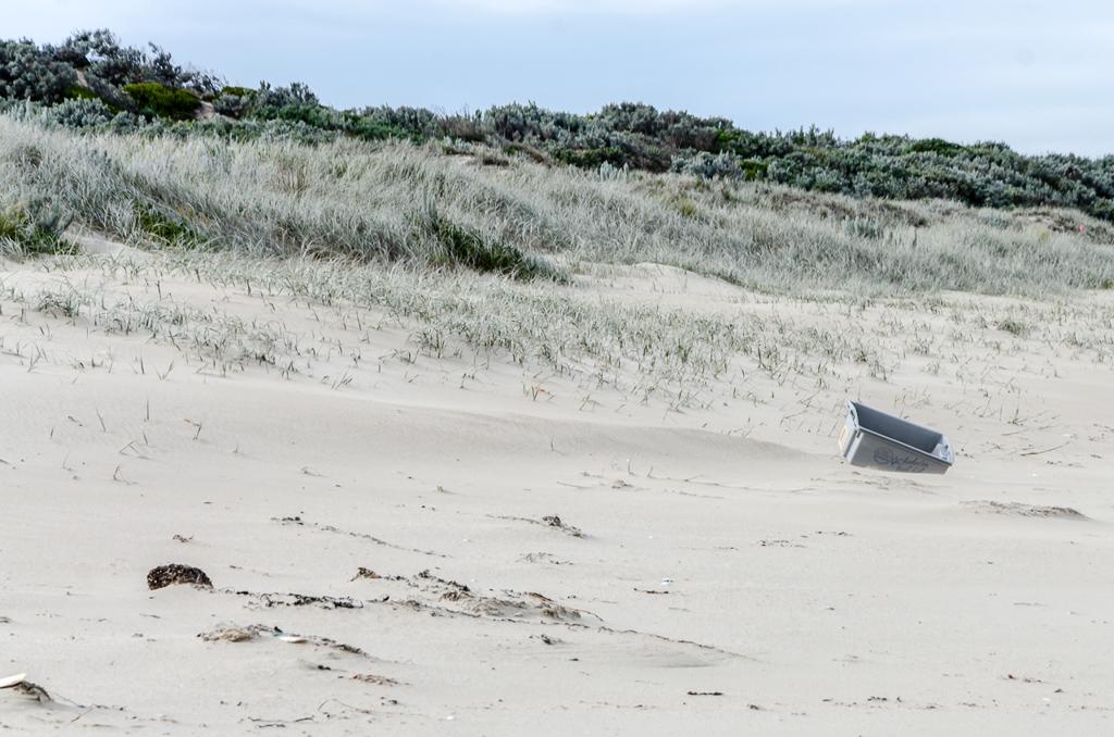 plastic-fishing-tub-on-beach