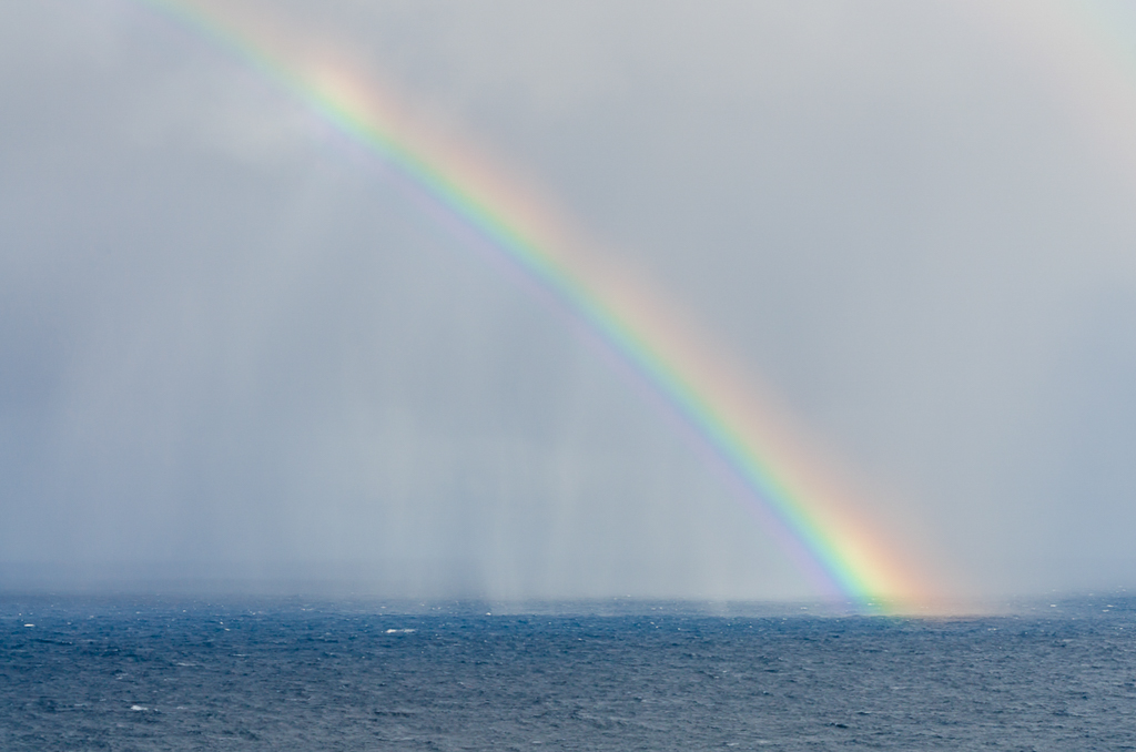 rain-and-rainbow-over-ocean