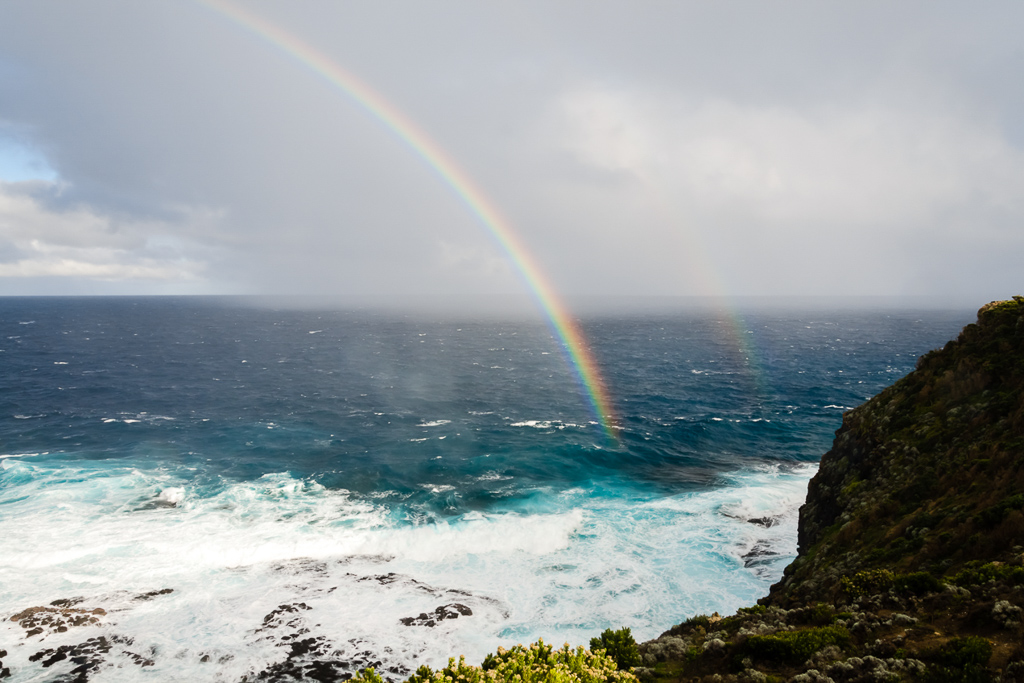 twin-rainbows-over-ocean