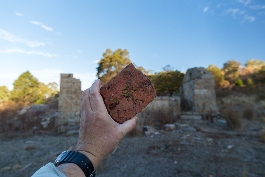 holding-red-brick-granite-cottage-ruins