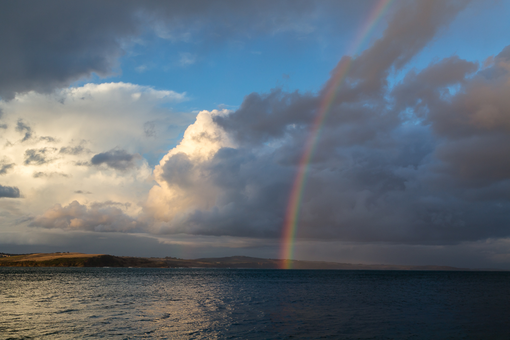 rainbow-rain-over-ocean