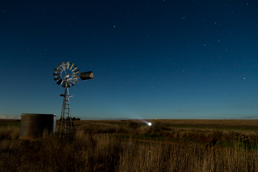 shining-torch-on-windmill-night