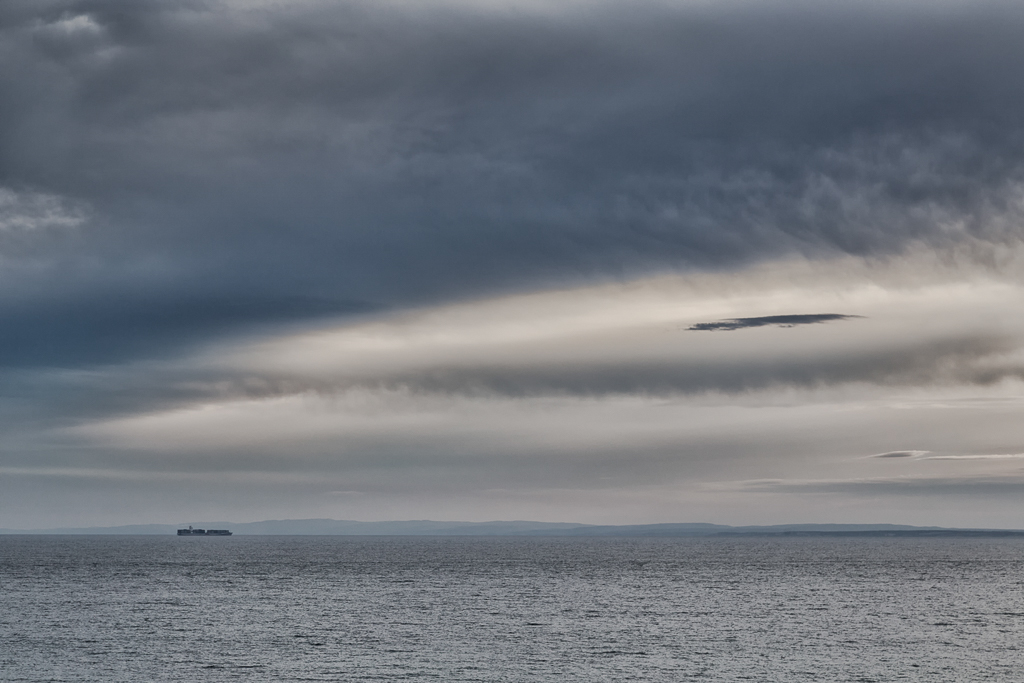 ship-at-sea-under-dark-clouds