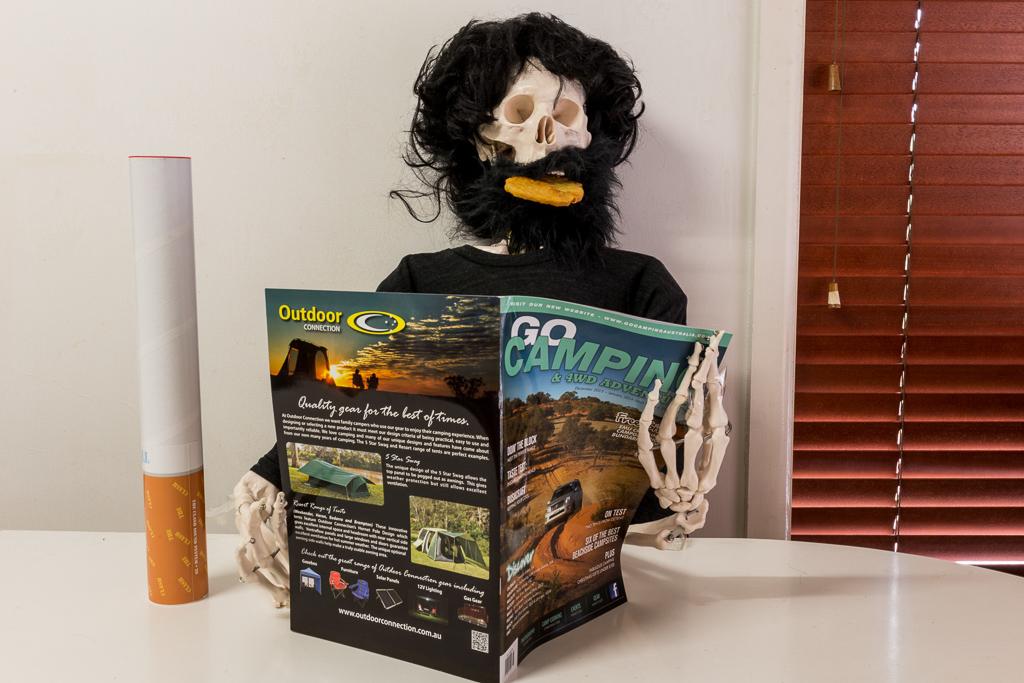 skeleton-reading-magazine