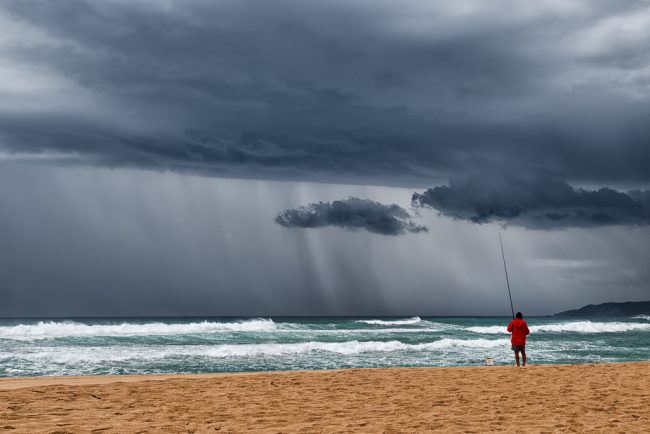 fishing-on-beach-storm