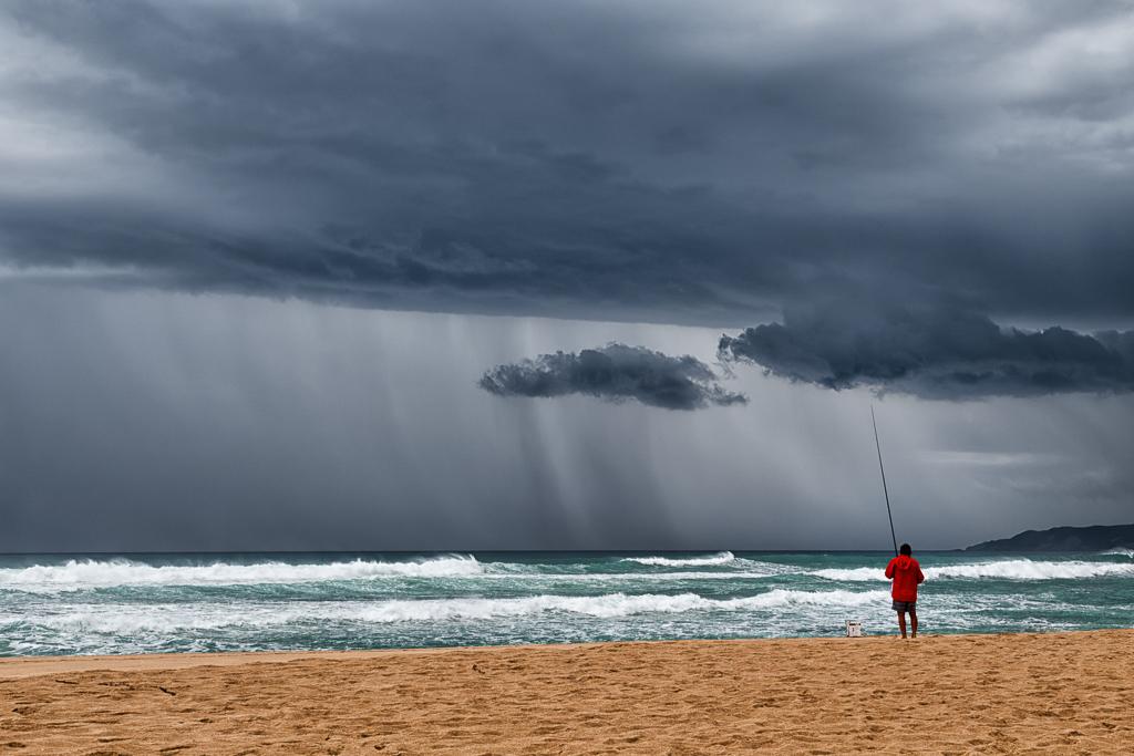 fishing-on-beach-storm
