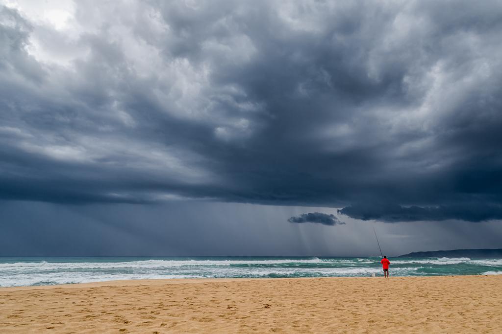 rain-and-fisherman-on-johanna-beach
