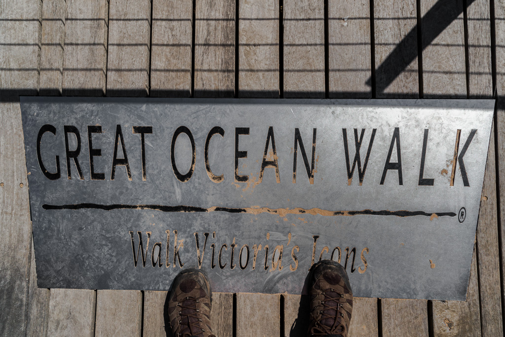 standing-on-great-ocean-walk-sign