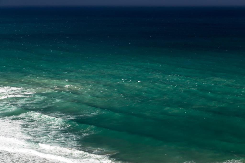 sun-over-ocean-green-water