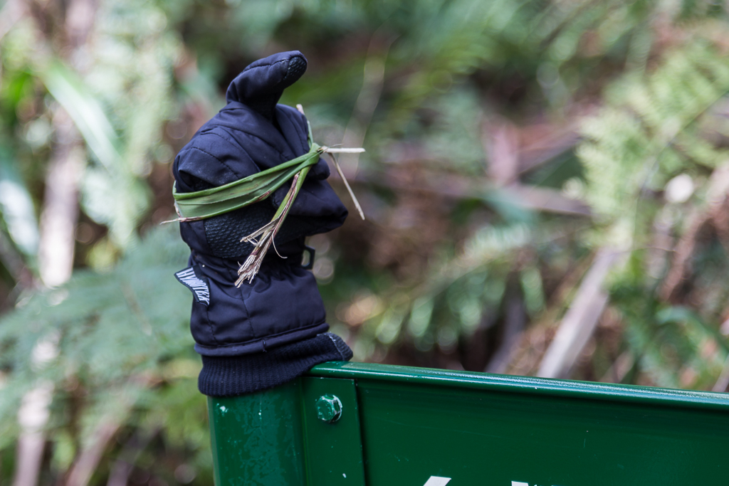 glove-on-fence-post