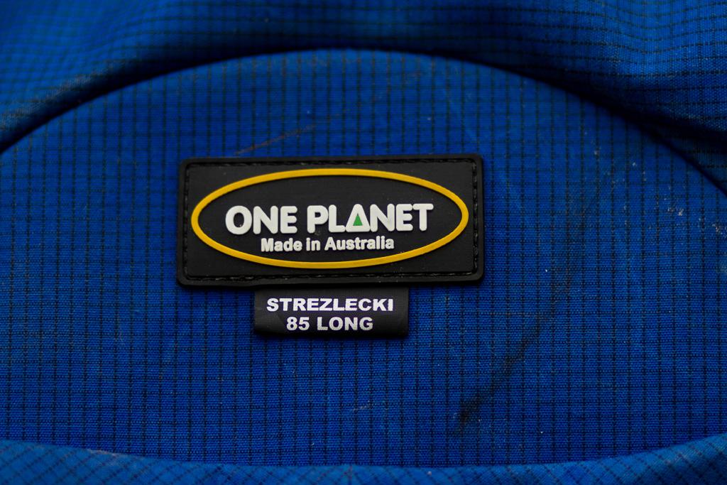 logo-one-planet-strezlecki-backpack