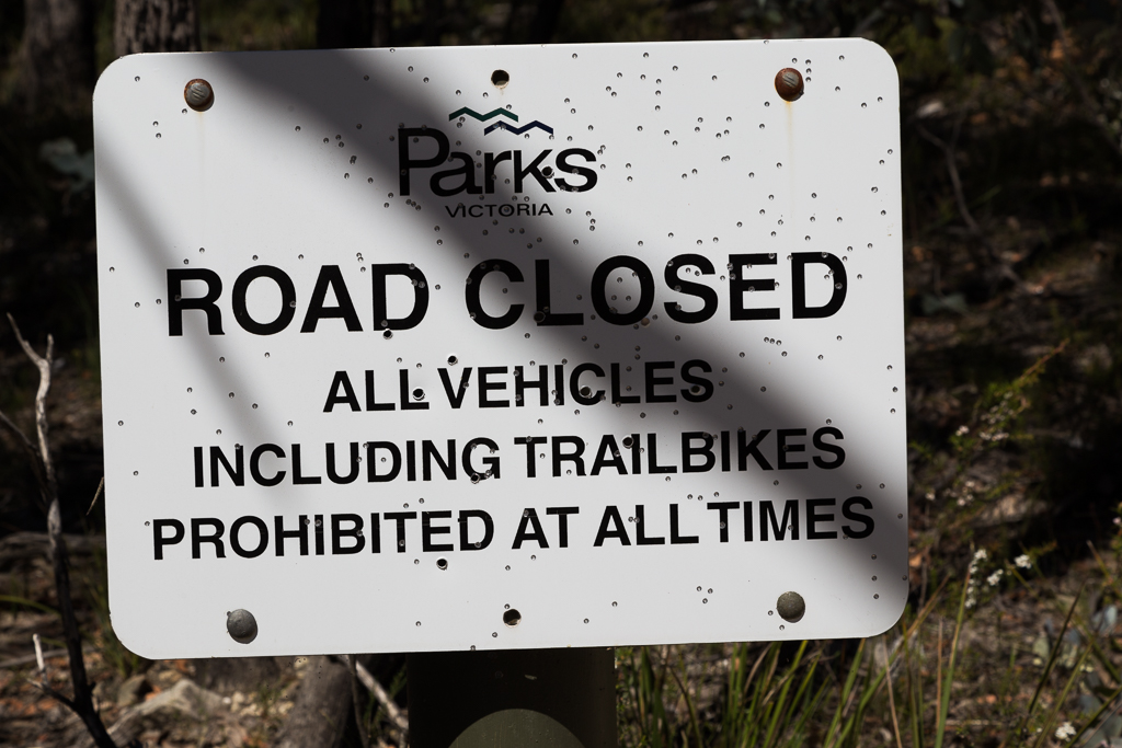 road-closed-sign-bullet-holes-lerderderg-state-park