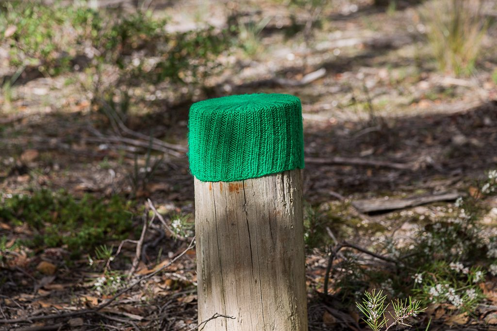 woolen-hat-on-timber-pole