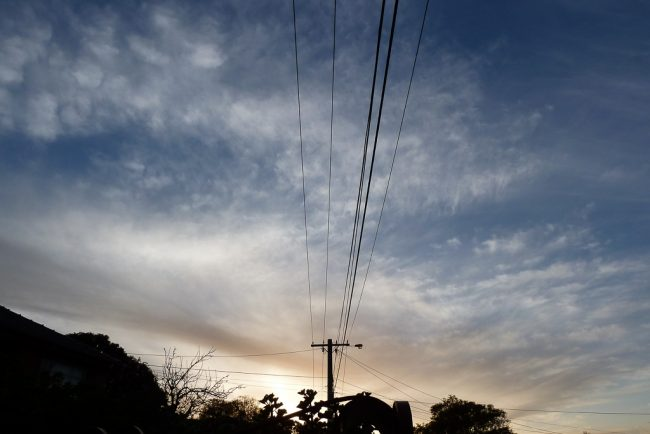 sunset-power-lines-suburbs
